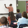 Teacher Using Interactive Whiteboard During Lesson — Stock Photo