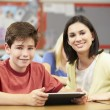 Pupils In Class Using Digital Tablet With Teacher — Stock Photo #27554743