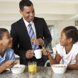 Father Having Breakfast With Children Before Work — Stock Photo
