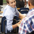 Stock Photo: Two Male Pupils Talking In Class