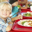 Elementary Pupils Enjoying Healthy Lunch In Cafeteria — Stock Photo #27554927