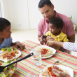 Family Eating Meal Together At Home — Stock Photo #27554977