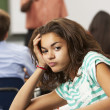 Bored Female Teenage Pupil In Classroom — Stockfoto
