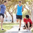 Group Of Male Runners Warming Up Before Run — Stock Photo #27555047