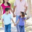 Stock Photo: Family Walking Along SuburbStreet