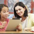 Stock Photo: Pupils In Class Using Digital Tablet With Teacher