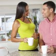 Stock Photo: Pregnant Woman And Husband Having Breakfast In Kitchen