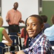 Stock Photo: Male Teenage Pupil In Classroom