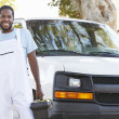Stock Photo: Portrait Of RepairmWith Van