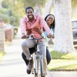 Couple Cycling Along Suburban Street Together — Stock Photo