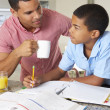 Father Helping Son With Homework In Kitchen — Stock Photo
