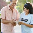 Charity Worker Collecting Sponsorship From Man In Street — Stock Photo