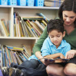 Elementary Pupil Reading With Teacher In Classroom — Stock Photo