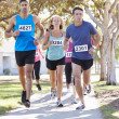 Group Of Runners On SuburbStreet — Stock Photo #27555239