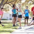 Group Of Runners Warming Up Before Race — Stock Photo
