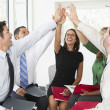 Stock Photo: Business Team Giving One Another High Five