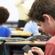 Pupil Sending Text Message On Mobile Phone In Class — Photo
