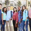Stock Photo: Group Of Teenage Pupils With Teacher Outside Classroom