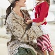 Stock Photo: Daughter Greeting Military Mother Home On Leave