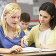 Teacher Reading With Female Pupil In Class — Stock Photo
