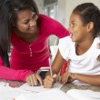 Mother Helping Daughter With Homework In Kitchen — Foto Stock