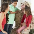 Family Greeting Military Father Home On Leave — Stock Photo #27555409