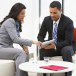 Stock Photo: BusinessmAnd BusinesswomHaving Informal Office Meeting