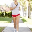 Female Runner Exercising On SuburbStreet — Stock Photo #27555479