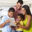 Family Using Digital Tablet In Kitchen Together — Stock Photo