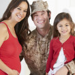 Family Greeting Military Father Home On Leave — Stock Photo #27555601