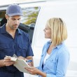 Customer Signing For Delivery From Courier — Stock Photo