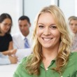 Stock Photo: Portrait Of BusinesswomSitting At Boardroom Table