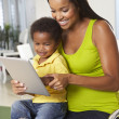 Mother And Son Using Digital Tablet In Kitchen Together — Stock Photo
