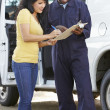 Customer Signing For Delivery From Courier — Stock Photo #27555737