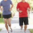Two Male Runners Exercising On Suburban Street — Stock Photo