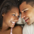 Couple Relaxing In Bed Wearing Pajamas — Stock Photo #27555881