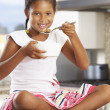 Girl In Kitchen Eating Bowl Of Breakfast Cereal — Stock Photo