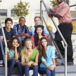 Group Of Teenage Pupils Outside Classroom With Teacher — Foto de Stock