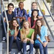 Stock Photo: Group Of Teenage Pupils Outside Classroom