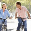 Stock Photo: Couple Cycling On SuburbStreet