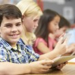 Pupils In Class Using Digital Tablet — Stock Photo #27556053