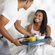 Man Bringing Woman Breakfast In Bed On Tray — Stock Photo