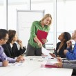 Stock Photo: Businesswoman Conducting Meeting In Boardroom