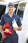 Portrait Of Delivery Driver With Flowers — Stock Photo