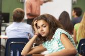 Bored Female Teenage Pupil In Classroom — Stock Photo