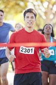 Male Runner Winning Marathon — Stock Photo