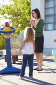 Teacher Supervising Breaktime At Elementary School — Stock Photo