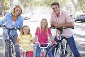 Family Cycling On Suburban Street — Stock Photo