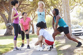 Group Of Female Runners Warming Up Before Run — Stock Photo