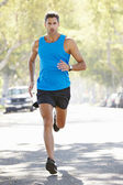 Male Runner Exercising On Suburban Street — Foto Stock